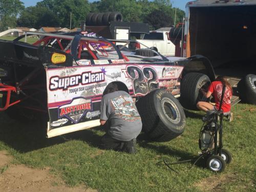 Tegan and her dad adjusting tires